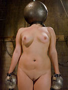 Femdom Claire Adams shackles and shocks her sub Davina